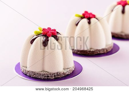 Flower Shape Mini Mousse Pastry Dessert Covered With Chocolate Velour And Decorated With Glaze