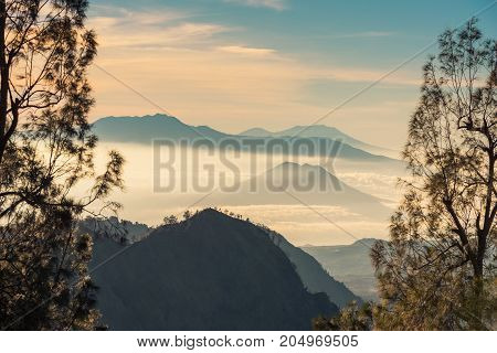Beautiful mountain and sea of clouds view during sunrise from viewpoint at Bromo Tengger Semeru National Park East Java Indonesia.