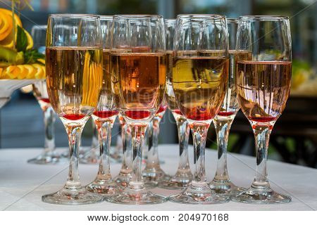 Glasses of champagne and fruit on the table served in the open air closeup