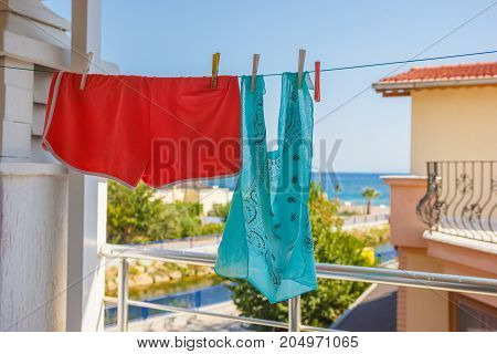 Bandana And Pink Shorts Hang On A Rope In The Street
