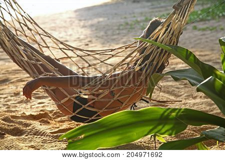 relax and happy woman on cradle or hammock beach background beautiful sunset sunrise