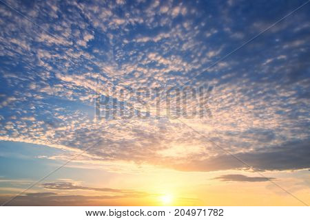 Colorful dramatic sky with cloud at sunset.Sky with sun background Clouds in the sunset sky Thailand