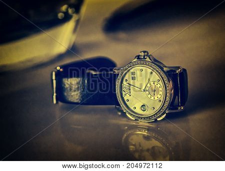 men's luxury wrist watch on a dark background. still life. selective focus toning retro style