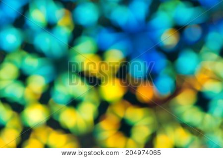 Abstract multicolored radiant background.Background in the form of blurred rhombuses.