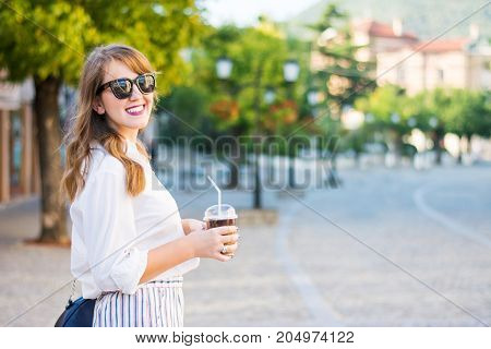 Fashionable Girl On The Street With Coffee To Go