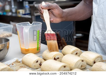 the preparation of viennoiserie pain au chocolat