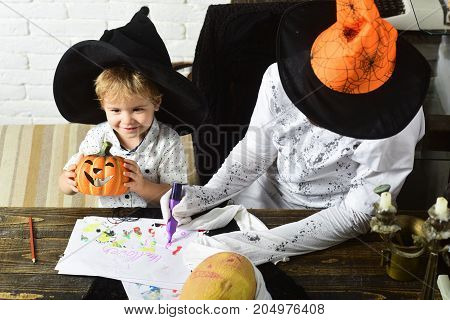 Halloween Party And Decorations Concept. Man And Kid