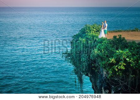 Closeup Happy couple at the cliff in Thailand. Honeymoon summer travel