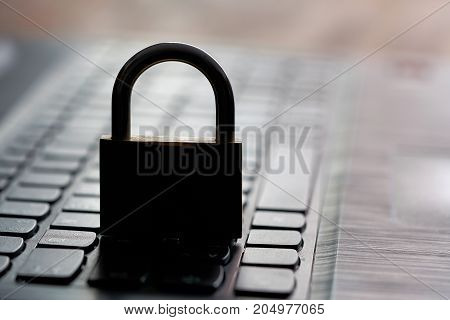 Computer keyboard and padlock as a symbol of Internet security