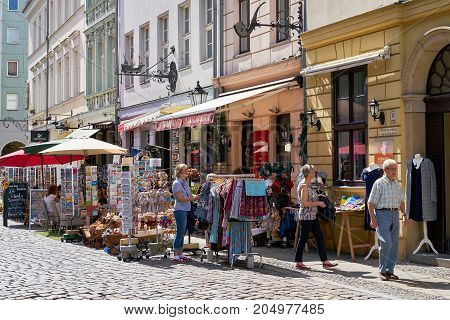 BERLIN, GERMANY - AUGUST 07, 2017: Tourists looking for souvenirs in a shopping street in the Nikolai-Quarter in Berlin-Mitte
