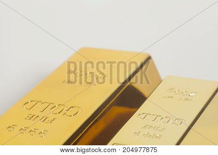 Gold bullion on a white background .