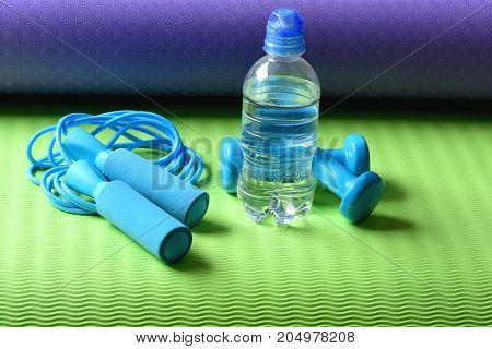 Bottle Or Fresh Water Near Jump Rope And Barbells