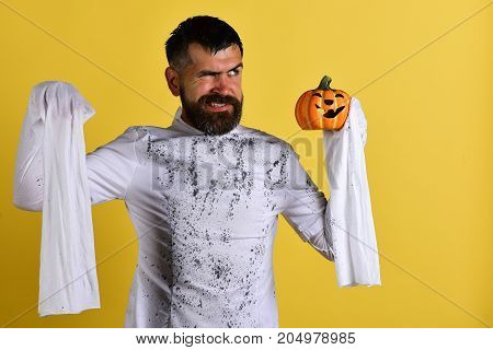 Guy With Beard Holds Orange Pumpkin With Smile