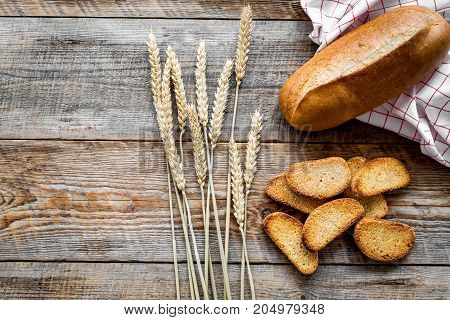 baking fresh wheaten bread on bakery work table wooden background top view mokeup