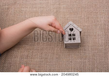 Child Holding A Model House On A Canvas