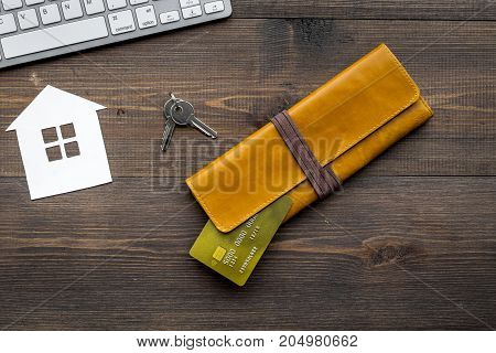 buy house online set with paper figures and keys on office desk wooden background top view