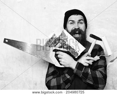 Bearded Worker Holding Various Building Tools With Happy Face