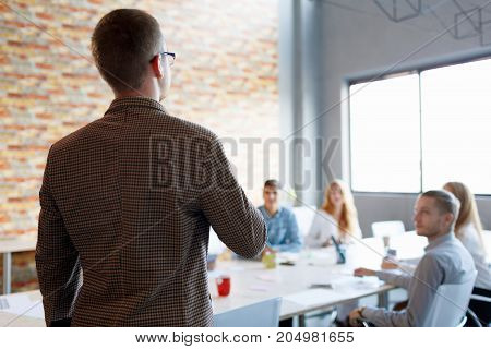 Handsome businessman handshaking with company coworker or partner at meeting, employer welcoming job candidate before interview.
