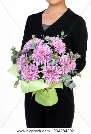 woman holds bouquet of red pink dahlia. Valentine's Day