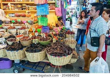 OAXACA MEXICO - MARCH 5: Shoppers in a typical market in Oaxaca Mexico on March 5 2017