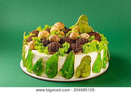 Homemade Cake Decorated With Colored Pears And Cream Puffs