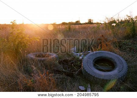 Spontaneous Dump Discarded Tires And Household Rubbish . Garbage Dump On The Side Of A Dirt Road. Th