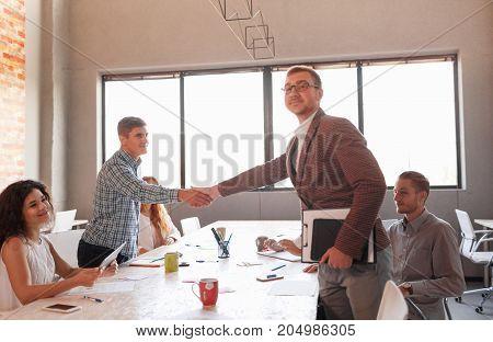 Business partnership meeting concept. Image businessmans handshake. Successful businessmen handshaking after good deal. Horizontal, blurred background