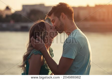 Young couple enjoy kissing and spending time together.