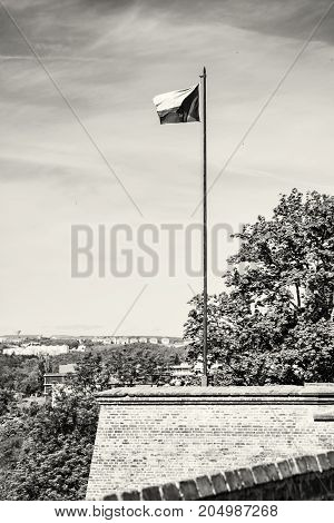 Czech flag on the Spilberk castle Brno southern Moravia Czech republic. State symbol. Black and white photo.