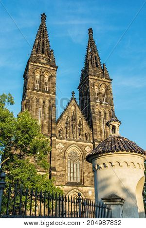 Beautiful basilica of Saint Peter and Saint Paul Vysehrad Prague Czech republic. Sunset photo. Religious architecture. Travel destination.