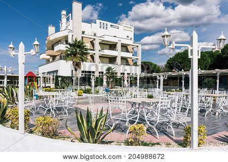 ALBANIA GOLEM- September 21 2015: Summer cafe near the hotel on the Adriatic coast. A blue sky with clouds a bright clear day