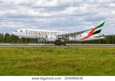 Pulkovo, Saint-Petersburg, Russia - August 10, 2017: Boeing 777 of Emirates airlines is landing. Has a special painte of Arsenal club