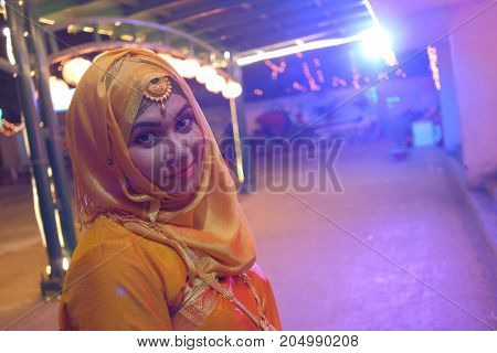 portrait of young indian woman in sari at wedding day.