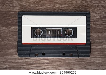 Vintage audio cassette tape on brown wooden background