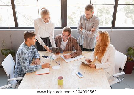 Corporate business team and manager in a meeting, close up. Entrepreneurs and business people conference in modern meeting room.