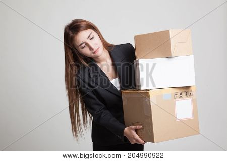 Young Asian Working  Woman With 3 Heavy  Shipping Boxes