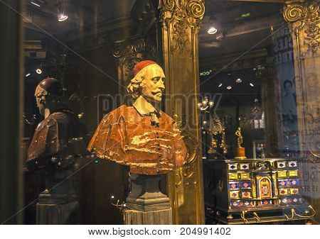 PARIS FRANCE - MARCH 28 2017: Bust of Cardinal Richelieu in the window of an antique store. Paris France.