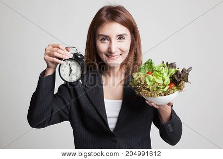 Young Asian Woman With Clock And Salad.
