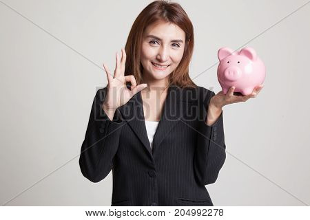 Asian Woman Show Ok  With Pig Coin Bank.