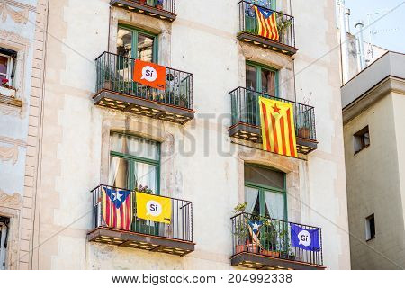 BARCELONA, SPAIN - September 16, 2017: Buildings with Catalonian flags and flags claiming the right to vote for the independence referendum from Spain