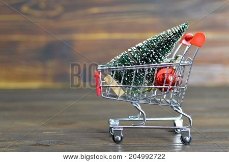 Shopping cart with Christmas tree and Christmas decoration