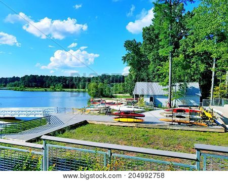 A boat dock rental area at a lake under a beautiful blue sky.