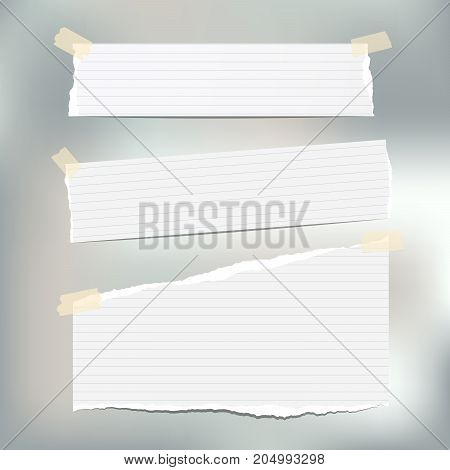 White ruled note, notebook, copybook paper strips stuck with sticky tape on gray background