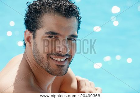 Young Man Sitting In Swimming Pool