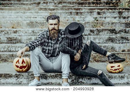 Halloween Couple Sitting On Grey Stairs