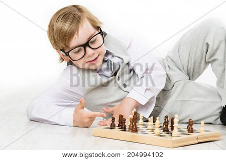 Child Playing Chess Smart Kid Boy in Business Suit Glasses Play Chess Chessboard