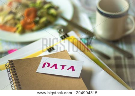 Data; Stack Of Documents. Working Or Studying While Eating.