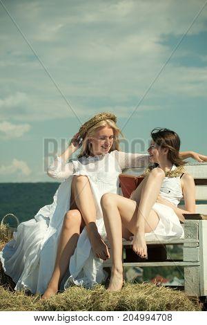 Women In White Dresses On Sunny Day