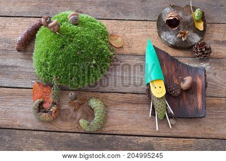 Funny figure made from pine cone and paper. Autumn decoration. Funny pinecone gnome.