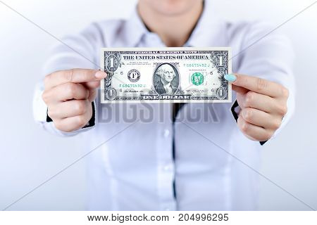 Businesswoman holding dollar banknotes isolated on a white background.Money in women's hands. American currency. One dollar banknotes
